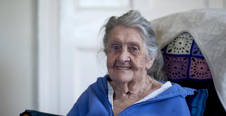 elderly lady sitting in a chair