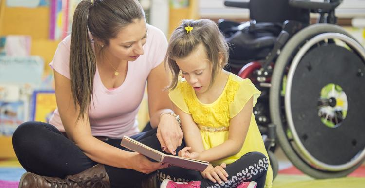 Young unpaid carer with disabled child