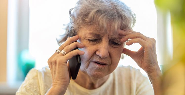Older woman speaking on the phone