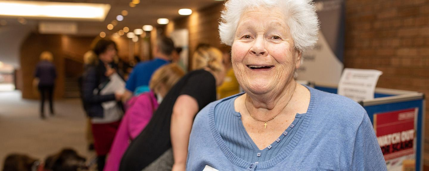 Smiling woman at a meeting