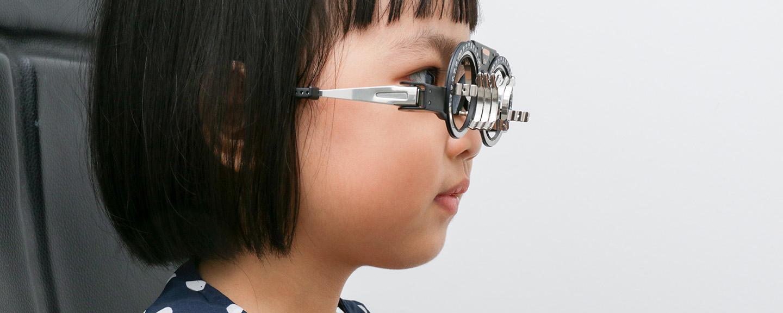 Young girl having an eye test