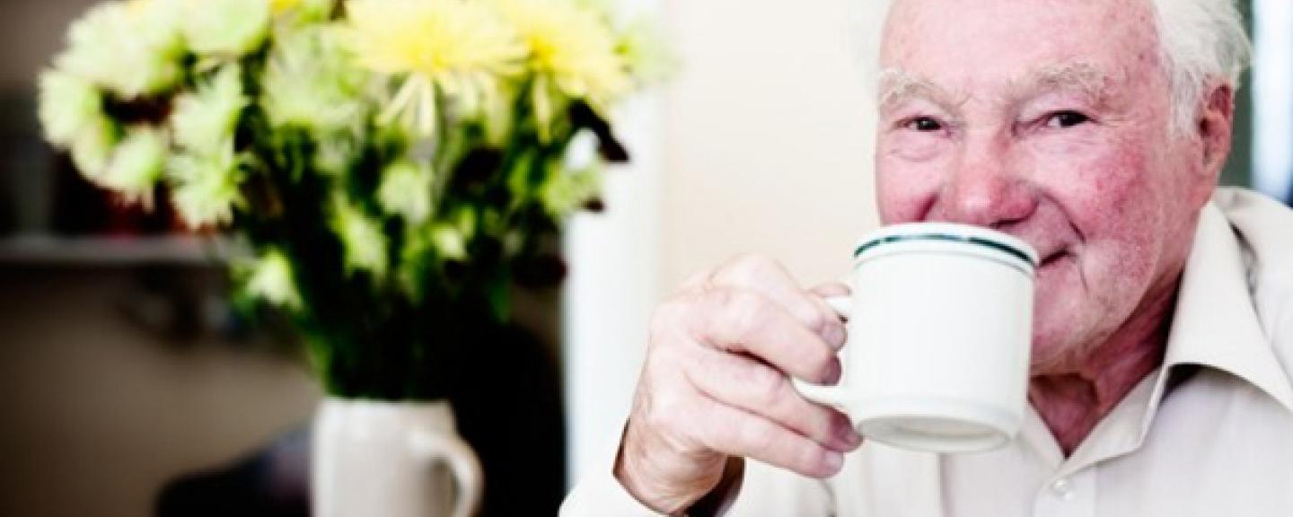 Older man with cup of tea