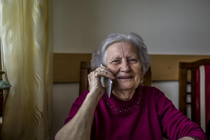 Elderly woman talking on the phone