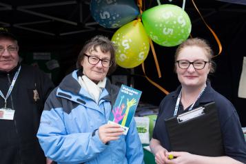 Healthwatch volunteer speaking to the public