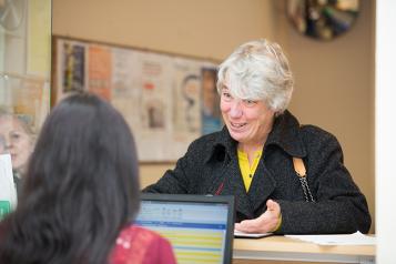 Woman at GP desk