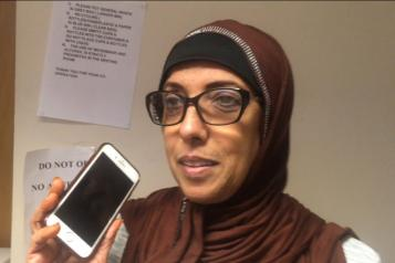 Lady in glasses and a headscarf