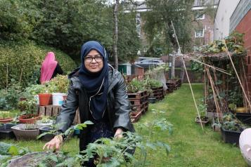 Bangladeshi woman enjoying gardening