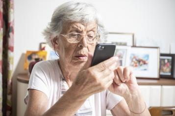 Older woman trying to use e-consult on her phone