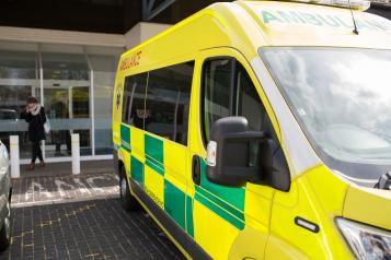 Hospital exterior with ambulance