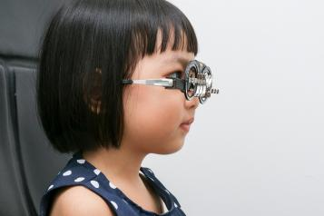 Young girl having an eye test