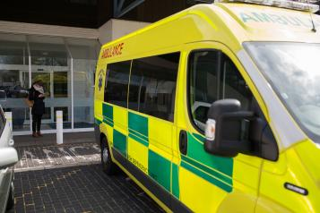 an ambulance parked outside a hospital