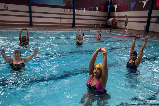 Exercise class at Cally Pool swimming pool. People join the class for reasons including weight loss and general fitness.