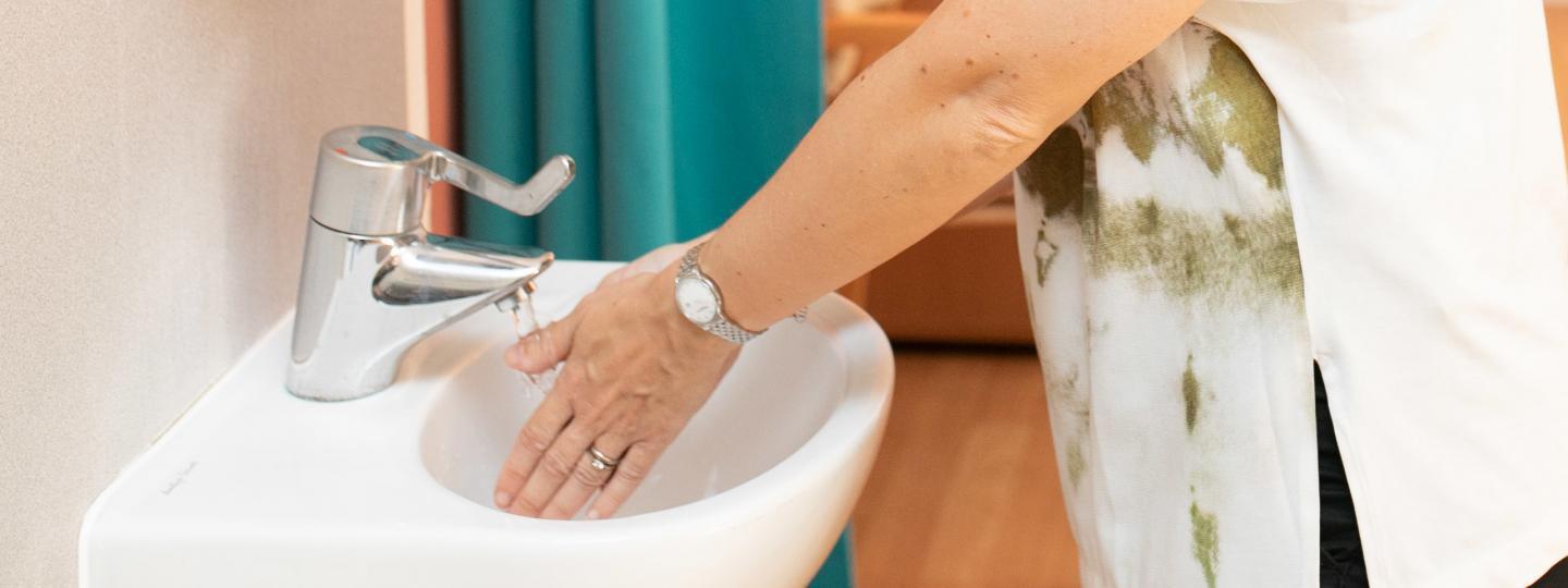 Woman washing her hands at a hospital sink