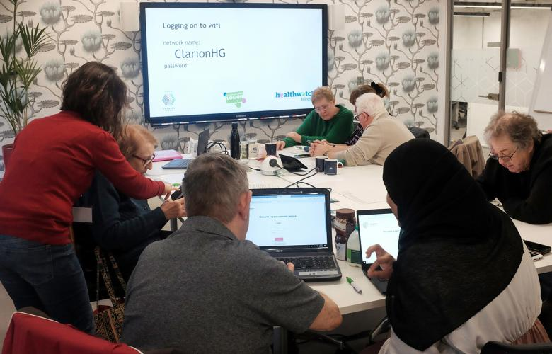 Volunteer digital champions and local residents at a Healthwatch training session