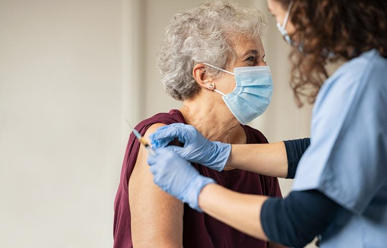 Older woman receiving a covid vaccination