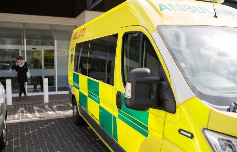 Hospital exterior with ambulance