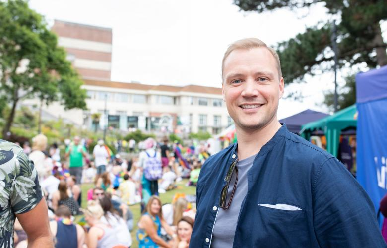 Smiling man at an outdoor event