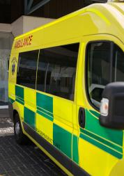 an ambulance parked outside a hospital